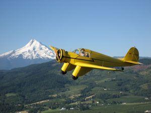 1937 Aeronca LC flying in front of Mt. Hood