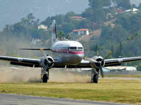 Flabob Express - Douglas DC-3  landing on grass