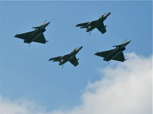 Dassault Rafales and Dassault Super Etendards fly over