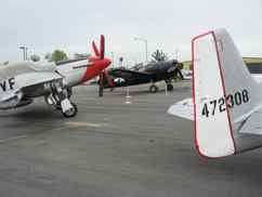 Grumman F6F Hellcat and two North American P-51 Mustangs