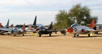 Grumman TAF-9J Cougar  (L); Grumman F9F-4 Panther (C);  Grumman TF-9J Cougar (R)