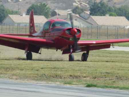 Meyers 200B (1959) landing on grass