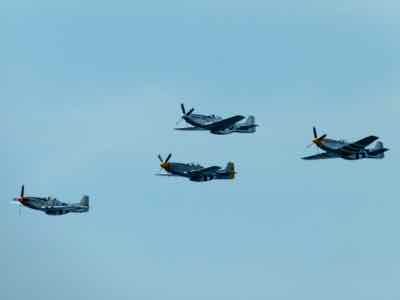P-51 Mustangs in formation at Arsenal of Democracy Fly-over