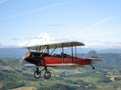 1928 Waco GXE flying by Mt. Hood