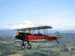 1928 Waco GXE flying by Mt. Hood
