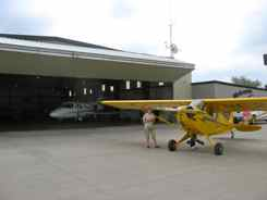 Cub comes out of the hangar ready to skim under the clouds