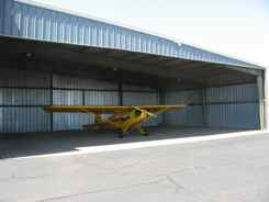 Keeping the Cub out of the sun, Tucumcari Airport