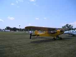 Jack ties the Cub down in Vintage Aircraft Parking Oshkosh
