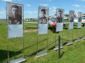 Photos of Soviet pilots line the walkway at the entrance to the outdoor exhibit at Monino.