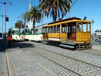 """Two Blackpool """"boat car"""" trams from 1934.  That's not a cable car they're with!  That's Streetcar No 578 and it was built in 1896… BEFORE the cable cars."""
