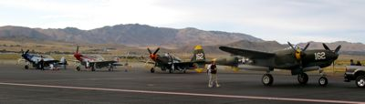 P-51 Mustangs and P-38 Lightning on display at the end of the day at Reno Air Races