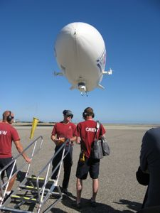 Zeppelin coming in for a landing - Crew chief hold the wind sock...